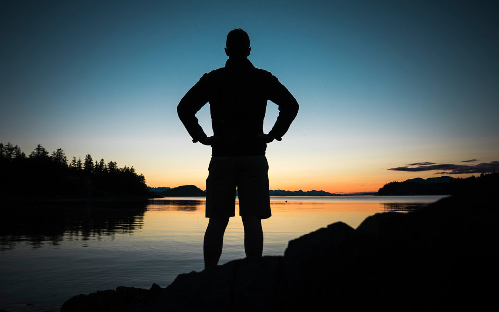 silhouette of a man at dusk